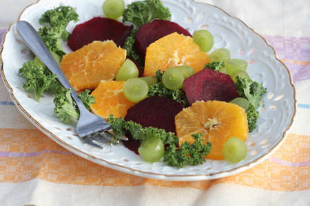 Fresh salad with beet, orange, kale and grapes . 写真素材