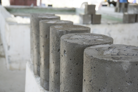 Wet cylinder concrete sample just take from curing tank