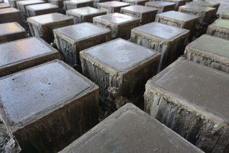 Cube concrete samples casting just finished pouring in steel mould and waiting hardening time