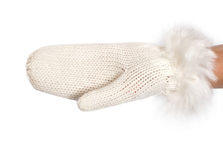Woman hand in a white warm knitted mitten isolated on white