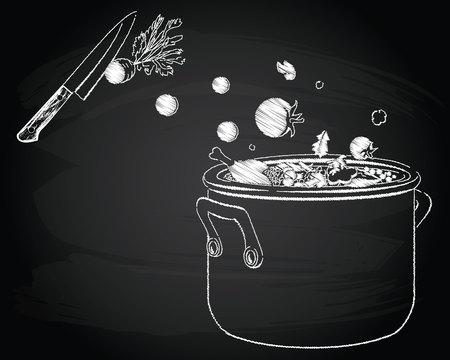 黒板背景に野菜のスープを調理