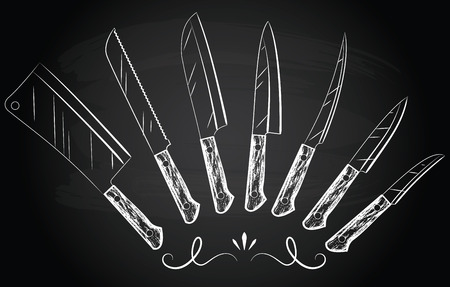 Set of steel kitchen knives on the chalkboard background