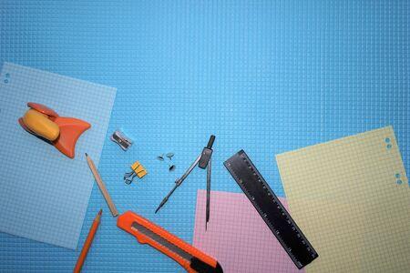 School supplies on blue background.