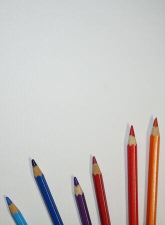 Multicolored pencils on white background. Stock Photo