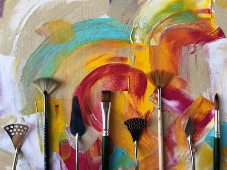 Brushes on abstract acrylic background. 写真素材