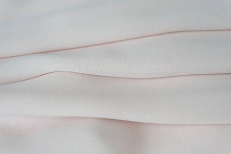 Smooth elegant pink textile (silk, satin) background. Wedding concept. Reklamní fotografie