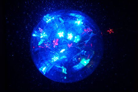 Magic crystal lights ball with defocused stars. Halloween concept. Christmas concept.