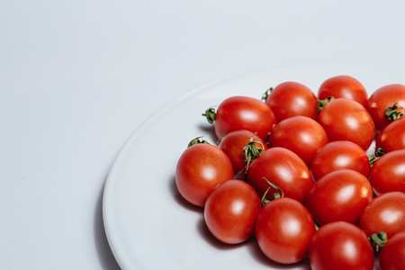 Bunch of red tasty fresh tomatos on the white background. Stock Photo