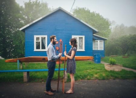 double reed: happy couple in love enjoying near house