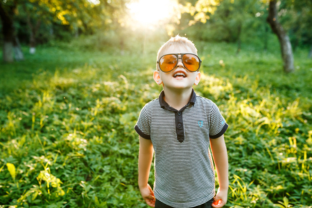 Boy in sunglasses in summer, toned photo