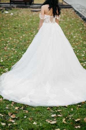 Beautiful bride in elegant white dress  posing