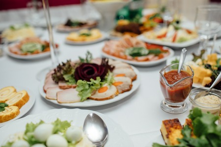 Tasty meat and vegetable snacks on the wedding table