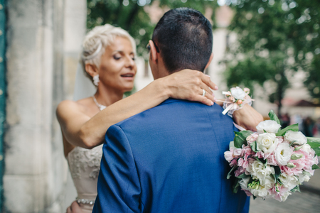 Woman kisses mans nose tender Stock Photo