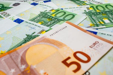 Euro banknotes close up. Several hundred euro banknotes Imagens