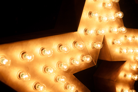 Decorative star with lamps on a background of wall. Archivio Fotografico