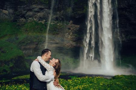 Amazing romantic view of happy couple near beautiful grand water