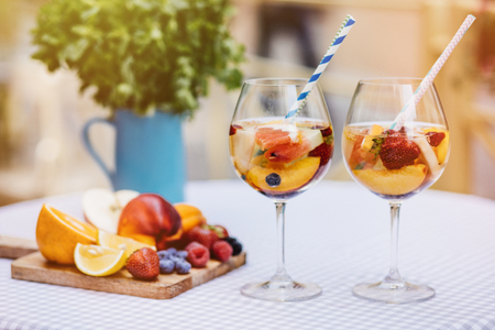 view of summer drinks, fruit cocktails on white wood table