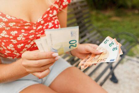 Female hands holding euro bills. Euro Money. Euro cash background. Standard-Bild