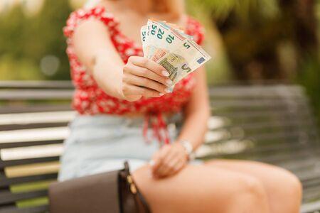 Female hands holding euro bills. Euro Money. Euro cash background. Stock Photo