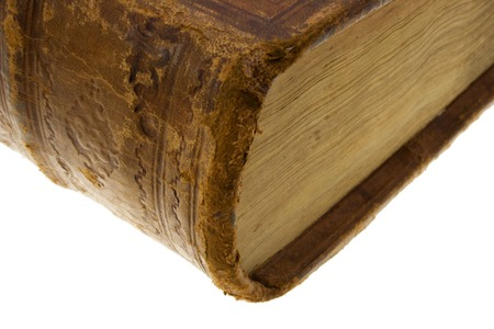 folio: corner of leather brown old book with yellow lock, isolated on white