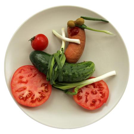 mini bike: Sausage biker at the cucumber tomato bike