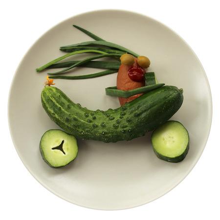 Fast sausage rider in green cucumber car