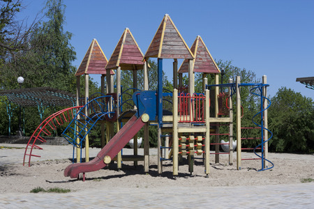 jungle gyms: Modern colorful playground without children ground outdoor photo