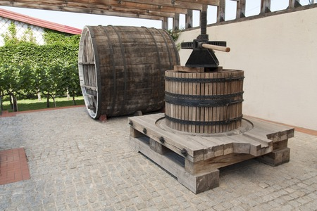 Grape harvest: old Wine press in a winery photo