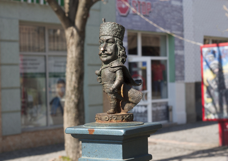 Small iron cast netsuke statuette decorating the center of Mukachevo town photo, Ukraine on May 1, 2017.