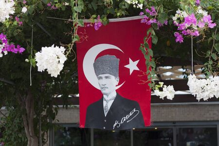 Showing red flag of national hero Ataturk in flower photo