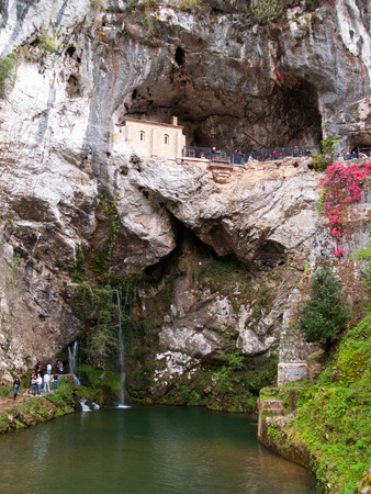 Sanctuary of Covadonga. Little church placed in a cliff. Covadonga, Asturias, Spain. photo