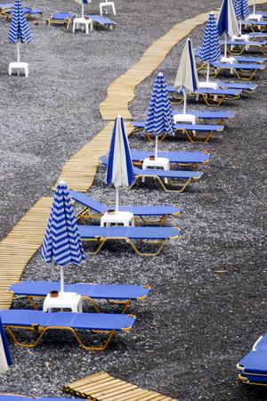 Beach with sunbeds 스톡 콘텐츠