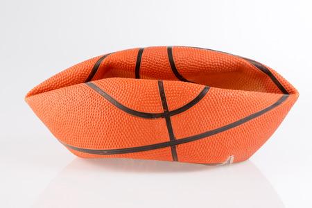 Deflated orange basketball ball