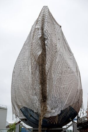 The boat is covered by a fishing net Reklamní fotografie