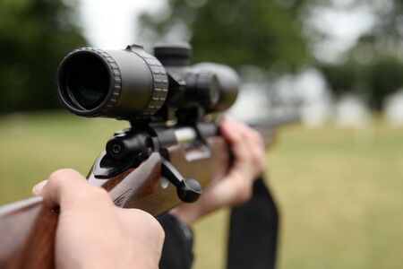 Hunter holding a rifle Foto de archivo