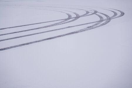 Car tires marks on snow