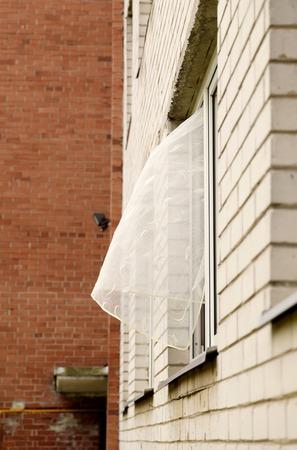 Open window and fluttering curtains Reklamní fotografie