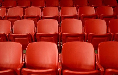 Empty red seats in stadium 写真素材