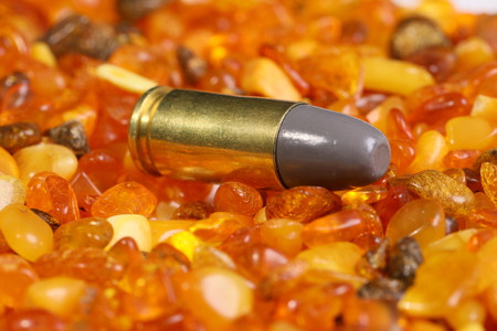 Bullet cartridge on the amber stones