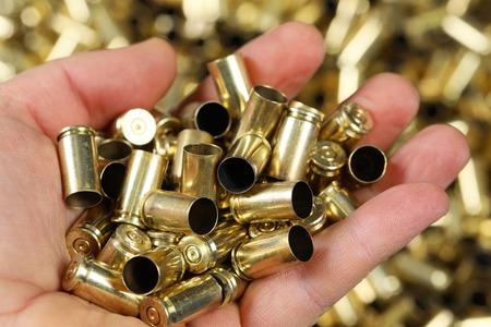 Gun bullets hold in hand