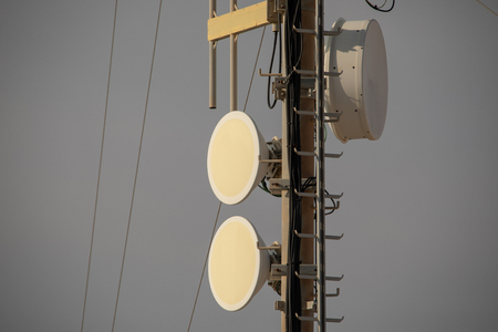 Telecommunication TV antennas with cell phone antennas and satellite dish Banco de Imagens