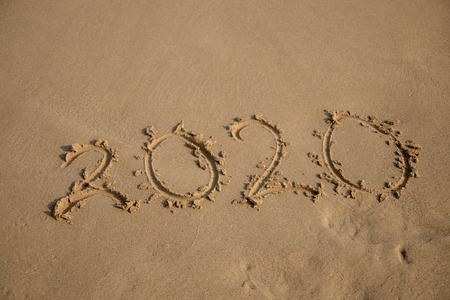 2020 Year written on the beach sand