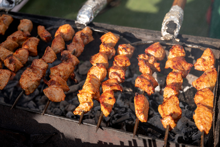 Grilling meat on a barbecue