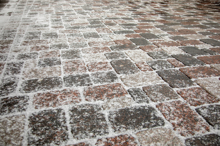 Old cobblestone pavement closeup