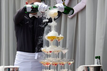 Catering service. Wedding slide champagne for bride and groom outdoors. Catering bar for celebration