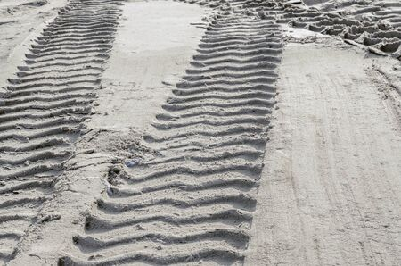 traces of a bulldozer in the sand. concept of construction and repair work. place of work of construction equipment