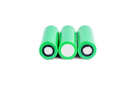 Three rechargeable batteries on a white background isolated. 18650 green batteries. device energy concept Archivio Fotografico
