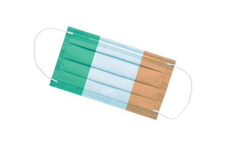 medical face mask with flag of ireland isolated on a white background. Ireland pandemic concept. attribute of Irish doctors. coronavirus in ireland. Ireland pollution news background