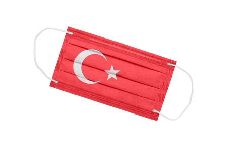 Medical mask with flag of Turkey isolated on a white background. Turkey pandemic concept. Attribute of coronavirus outbreak in Turkey. Medicine in Turkey.