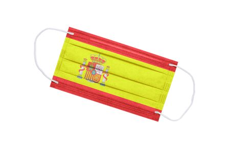 medical face mask with flag of spain isolated on a white background. pandemic concept in spain. attribute of a coronavirus outbreak in Spain. Medicine in Spain